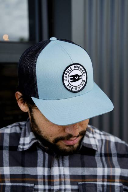 marble brewery round patch hat men's side view